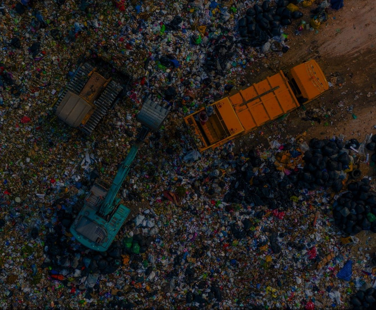Garbage pile  in trash dump or landfill, Aerial view garbage trucks unload garbage to a landfill,  global warming.